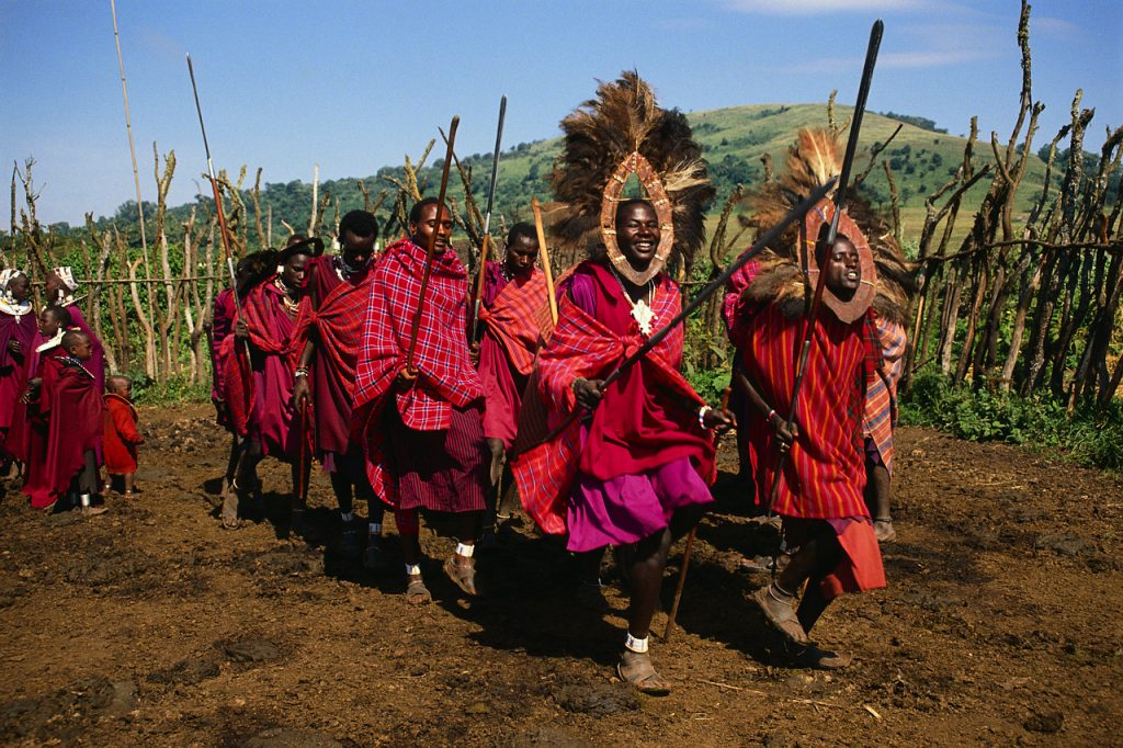 A group of Masai men perform a traditional dance in their village. Tanzania